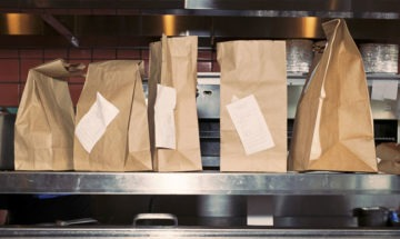 Take out paper bags from a restaurant counter via NPR
