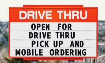 Drive thru sign via ISTOCK.COM / SHAUNL for QSR Magazine