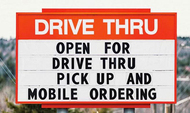 Drive thru sign via ISTOCK.COM / SHAUNL for QSR Magazine