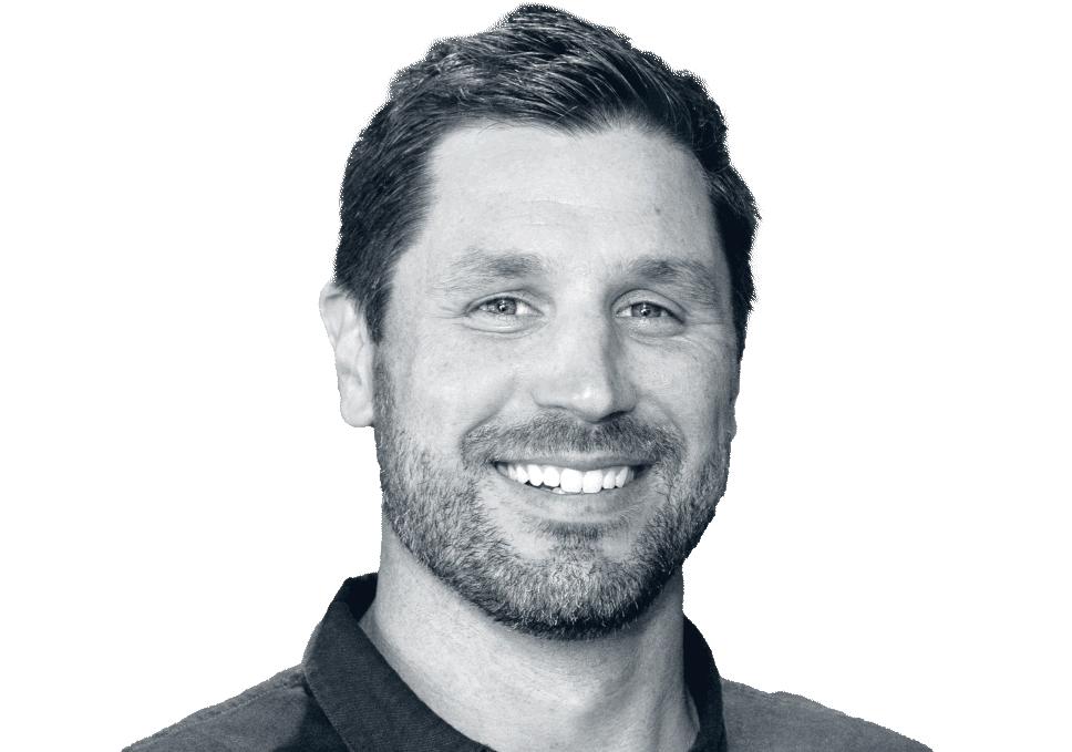 Black and white headshot of Garrett Mills with RibCrib